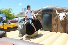 mechanical bull pictures.Mechanical bull rentals in Texas is made easy by calling by b-amused.They will take care of all you needs when renting mechanical bull.When you contact  b-amused about renting mechanical bull they will need your location, date, and time needed. B-amused will bring the mechanical bull for your rental on time and ready to entertain your guest.The guest will really enjoy the mechanical bull rental you have provided for them.Your guest will come to you and say thank you so much for renting the mechanical bull for your party. They will ask b-amused can you help me find mechanical bull pictures in Texas.B-amused will say well sure mechanical bull rentals work for church events, birthday parties, company parties, fairs, festivals, project graduations, graduation parties and rodeos. The cities in Texas served by mechanical bull pictures  are Dallas, Addison, Plano, Austin, Waco, Frisco, Fort Worth and Ennis. Some other cities severed by b-amused mechanical bull rentals are Abilene, Fair field, Denton, Houston, Red Oak, Garland, Bell, Richardson, Irving, Cedar Hill, Gram, May bank, Temple and Farmers Branch.Hope this helps you find mechanical bull rental Fort Worth Texas.