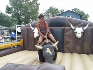 This girl wanted some Mo. This young lady enjoyed riding mo bull she was quite good at it. Mo bull didn't mind it likes a good rider every now and then.  Mo bull likes to make riders happy.  The mechanical bull is very popular for birthday parties and festivals