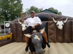 Gabriel cooking on Mo. Mo bull was really enjoyed in Spring Texas at the Texas craw fish festival. Many tried to ride Mo bull the mechanical bull but most failed. I had lots of good help when it came to entertaining the guest wit mo bull.  It was a lot of fun talking bull to the riders it would make most fall off of mo bull sooner than they expected. It was the first time to use my mo bull signs to lure in the riders.